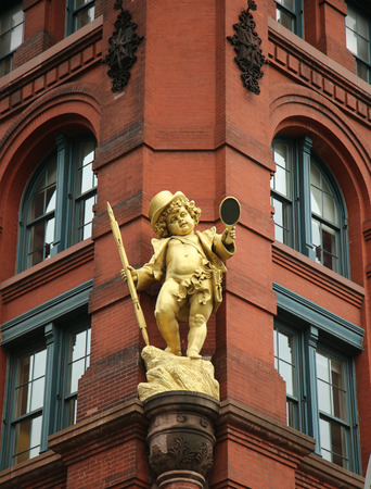 wagner: NEW YORK - JUNE 16, 2016: Historic Puck Building with gilded statue of Shakespeares character Puck at Wagner Graduate School of Public Service in Lower Manhattan