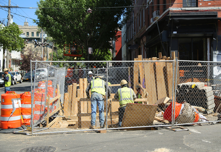 consolidated: BROOKLYN, NEW YORK - JUNE 9, 2016: Constriction workers repair street in Brooklyn, New York