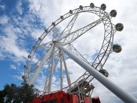 precinct: MELBOURNE, AUSTRALIA - JANUARY 31, 2016: The Melbourne Star 120 m (394 ft) tall giant Ferris Wheel in the Waterfront City precinct in the Docklands area of Melbourne