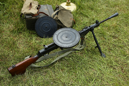 encampment: OLD BETHPAGE, NEW YORK - MAY 22, 2016: World War II Soviet Army military memorabilia with Degtyaryov machine gun on display during World War II encampment in Old Bethpage, NY