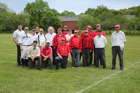new rules: OLD BETHPAGE, NEW YORK - MAY 22, 2016: Baseball team in 19th century vintage uniform during old style base ball play following the rules and customs from 1864 in Old Bethpage Village Restoration Editorial