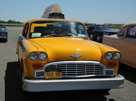 checker: BROOKLYN, NEW YORK - JUNE 12, 2016: Checker Taxi Cab produced by the Checker Motors Corporation in 1976 on display at the Antique Automobile Association of Brooklyn annual Spring Car Show