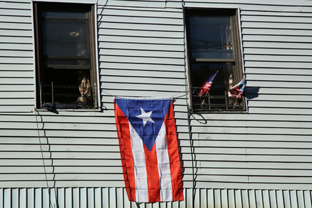 puerto rican flag: BROOKLYN, NEW YORK - JUNE 12, 2016: Puerto Rican flag in Brooklyn, New York. The Puerto Rican Day Parade takes place annually in the United States along Fifth Avenue in Manhattan Editorial