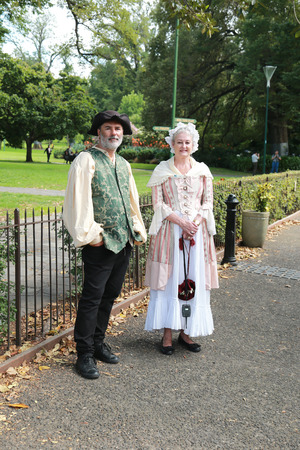 18th: MELBOURNE, AUSTRALIA - JANUARY 27, 2016: Cooks Cottage volunteers dressed in 18th century costumes.  Cooks Cottage is located in the Fitzroy Gardens, Melbourne, Australia.