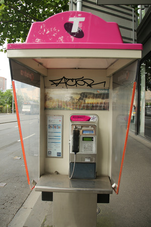 payphone: MELBOURNE, AUSTRALIA - JANUARY 24, 2016: Old style Telstra Payphone in Melbourne, Australia. Telstra switches on public Wi-Fi hotspots, offering free access.