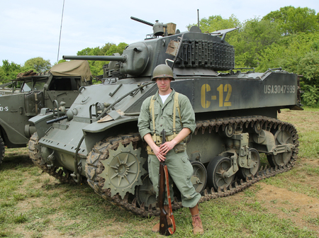 encampment: OLD BETHPAGE , NEW YORK - MAY 22, 2016: World War II Encampment participant in World War II American Army uniform in Old Bethpage, NY