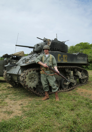wehrmacht: OLD BETHPAGE , NEW YORK - MAY 22, 2016: World War II Encampment participant in World War II American Army uniform in Old Bethpage, NY