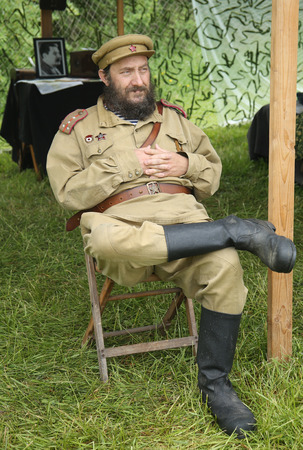 wehrmacht: OLD BETHPAGE , NEW YORK - MAY 22, 2016: World War II Encampment participant in World War II Red Army uniform in Old Bethpage, NY