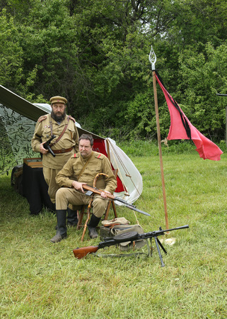 encampment: OLD BETHPAGE , NEW YORK - MAY 22, 2016: World War II Encampment participant in World War II Red Army uniform in Old Bethpage, NY