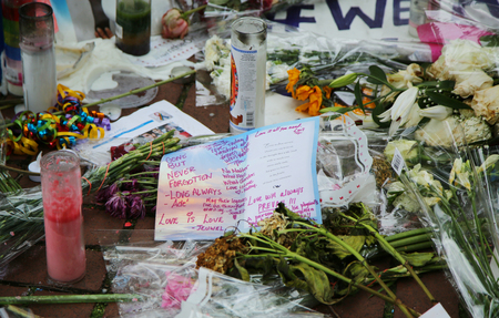 outside shooting: Memorial outside the gay rights landmark Stonewall Inn for the victims of the mass shooting in Pulse Club, Orlando in New York City
