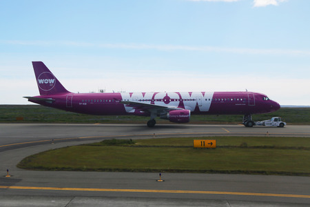 REYKJAVIK, ICELAND - JULY 6, 2016:Wow Air aircraft on tarmac at Keflavik International Airport. WOW air is an Icelandic low-cost carrier Editorial