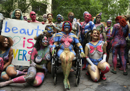 NEW YORK - JULY 9, 2016: Painted fully nude models of all shapes and sizes celebrate third NYC Body Painting Day in midtown Manhattan featuring artist Andy Golub in New York Éditoriale