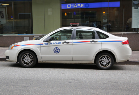 NEW YORK - JULY 9, 2016: Postal Police providing security near Grand Central Station in Midtown Manhattan Sajtókép