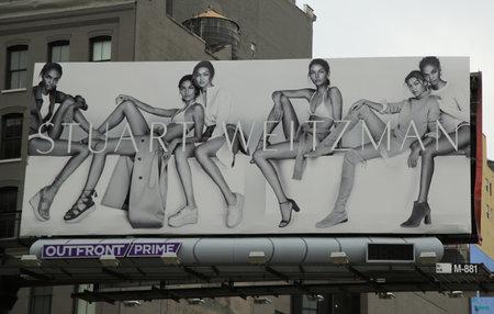 controversial: NEW YORK - JUNE 16, 2016: Stuart Weitzman controversial billboard in Lower Manhattan Editorial