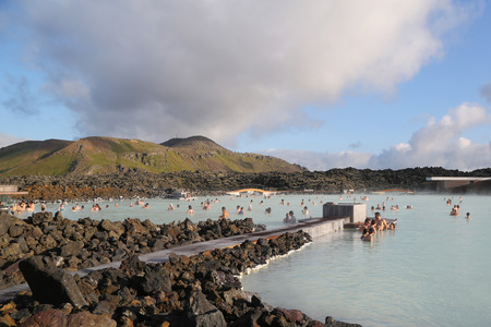 therapy geothermal: ICELAND - JULY 5, 2016: Visitors enjoying famous Blue Lagoon Geothermal Spa in Iceland. The Blue Lagoon geothermal spa is one of the most visited attractions in Iceland