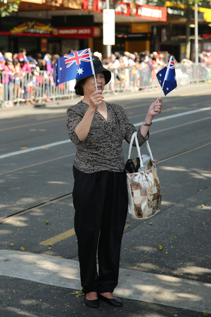 spectator: MELBOURNE, AUSTRALIA - JANUARY 25, 2016: Spectator during Australia Day Parade in Melbourne Editorial