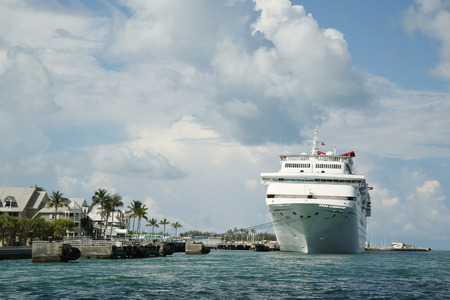 KEY WEST, FLORIDA - JUNE 1, 2016: Carnival Fantasy Cruise Ship anchors at the Port of Key West. Carnival Fantasy is the lead ship of the Fantasy-class of cruise ships operated by Carnival Cruise Line Editöryel