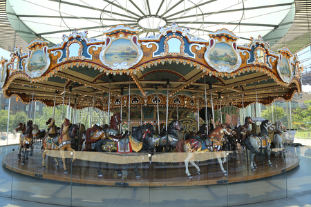 jane: BROOKLYN, NEW YORK - JULY 19, 2016: Traditional fairground Janes carousel in Brooklyn. It is historic and beautifully restored carousel build in 1922 a gift of Jane and David Walentas