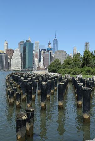 BROOKLYN, NEW YORK - JULY 19, 2016: Manhattan skyline panorama from Brooklyn Bridge Park