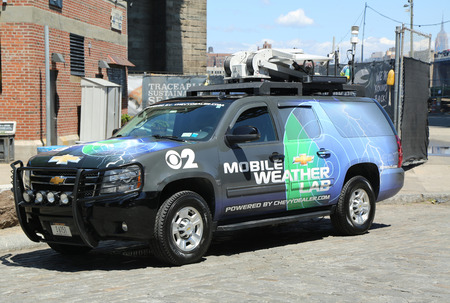 climatology: BROOKLYN, NY- JULY 19, 2016: CBS Channel 2 mobile weather lab in Brooklyn Bridge Park. The Weather Lab has high-tech weather gear that allow to measure wind speed, humidity, rainfall , temperature Editorial