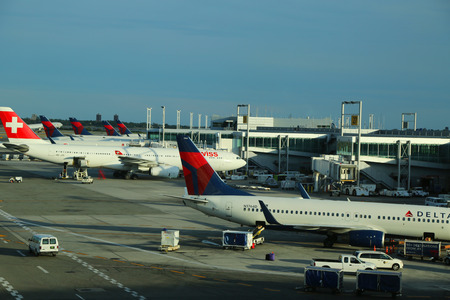 best travel destinations: NEW YORK- JULY 2, 2016: Delta Airlines and Swiss Airlines planes on tarmac at Terminal 4 at JFK International Airport. JFK is one of the biggest airports in the world with 4 runways and 8 terminals