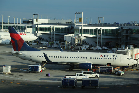 jfk: NEW YORK- JULY 2, 2016: Delta Airlines plane on tarmac at Terminal 4 at JFK International Airport. JFK is one of the biggest airports in the world with 4 runways and 8 terminals