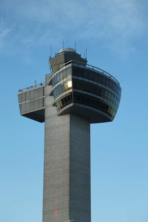 inhabited: NEW YORK- JULY 2, 2016: Air Traffic Control Tower at John F Kennedy International Airport. Over sixty airlines operate out of JFK with direct flights to all six inhabited continents