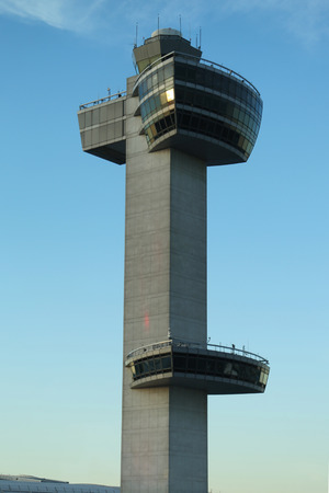 best guide: NEW YORK- JULY 2, 2016: Air Traffic Control Tower at John F Kennedy International Airport. Over sixty airlines operate out of JFK with direct flights to all six inhabited continents