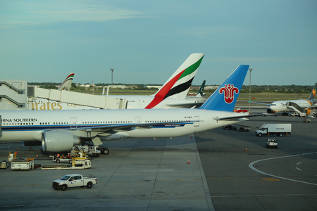 NEW YORK- JULY 2, 2016:China Southern and Emirates Airlines planes on tarmac at Terminal 4 at JFK International Airport. JFK is one of the biggest airports in the world with 4 runways and 8 terminals Editorial