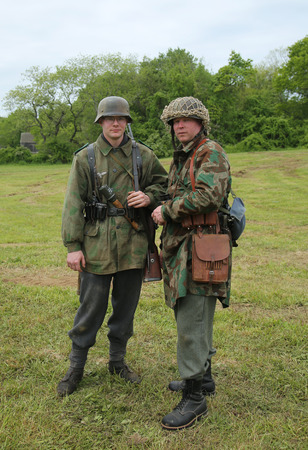 encampment: OLD BETHPAGE , NEW YORK - MAY 22, 2016: World War II Encampment participants in World War II German Army uniform in Old Bethpage, NY