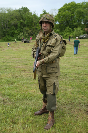 wehrmacht: OLD BETHPAGE , NEW YORK - MAY 22, 2016: World War II Encampment participants in World War II American Army uniform in Old Bethpage, NY Editorial