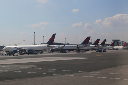kennedy: NEW YORK - JULY 6, 2016: Delta Airlines planes at the gate Terminal 4 at JFK International Airport in New York