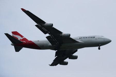 airways: NEW YORK - JULY 28, 2016: Qantas Airways Boeing 747 descending for landing at JFK International Airport in New York