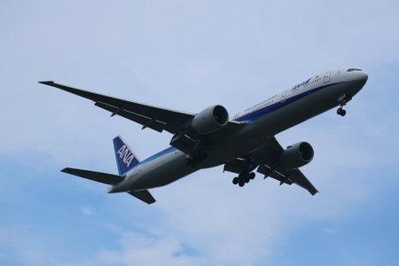 NEW YORK - JULY 28, 2016: All Nippon Airways Boeing 777 descending for landing at JFK International Airport in New York