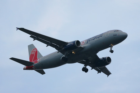 jetblue: NEW YORK - JULY 28, 2016: JetBlue Airways Boston Red Sox livery Airbus A320 descending for landing at JFK International Airport in New York
