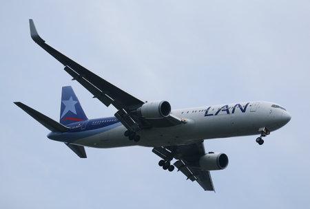 NEW YORK - JULY 28, 2016: Lan Airlines Boeing 787 Dreamliner descending for landing at JFK International Airport in New York