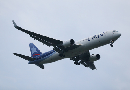 best travel destinations: NEW YORK - JULY 28, 2016: Lan Airlines Boeing 787 Dreamliner descending for landing at JFK International Airport in New York