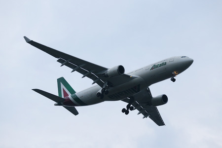 NEW YORK - JULY 28, 2016: Alitalia Airbus A330 descending for landing at JFK International Airport in New York