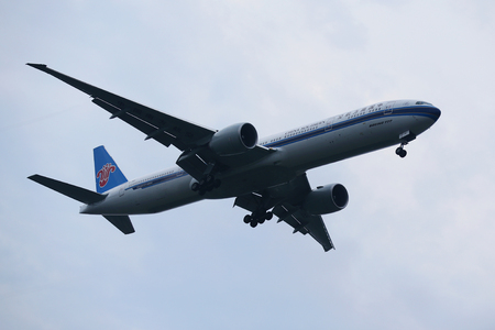 airstrip: NEW YORK - JULY 28, 2016: China Southern Boeing 777 descending for landing at JFK International Airport in New York