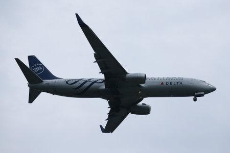 NEW YORK - JULY 28, 2016: Delta Air Lines SkyTeam livery Boeing 737 descending for landing at JFK International Airport in New York