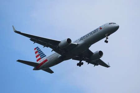 american airlines: NEW YORK - JULY 28, 2016: American Airlines Boeing 757 descending for landing at JFK International Airport in New York