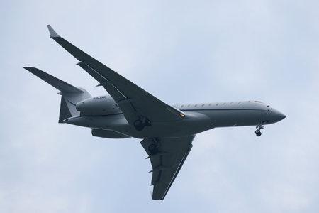 hubs: NEW YORK - JULY 28, 2016: Bombardier Global Express plane descending for landing at JFK International Airport in New York Editorial