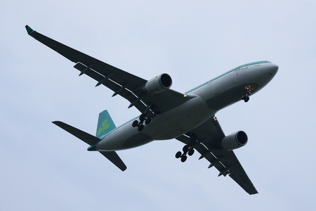 best travel destinations: NEW YORK - JULY 28, 2016: Aer Lingus plane descending for landing at JFK International Airport in New York. Aer Lingus, is the flag carrier airline of Ireland and the second-largest airline in Ireland