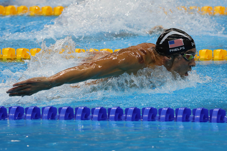 olympic ring: RIO DE JANEIRO, BRAZIL – AUGUST 8, 2016: Olympic champion Michael Phelps of United States swimming the Mens 200m butterfly at Rio 2016 Olympic Games Editorial