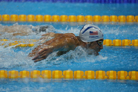 the olympic games: RIO DE JANEIRO, BRAZIL – AUGUST 8, 2016: Olympic champion Michael Phelps of United States swimming the Mens 200m butterfly at Rio 2016 Olympic Games Editorial