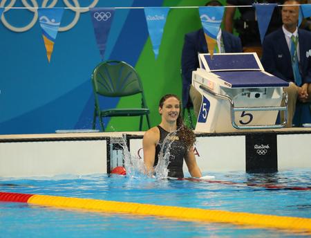 backstroke: RIO DE JANEIRO, BRAZIL - AUGUST 8, 2016: Katinka Hosszu of Hungary celebrates winning gold in the Womens 100m backstroke Final of the Rio 2016 Olympic Games at the Olympic Aquatics Stadium
