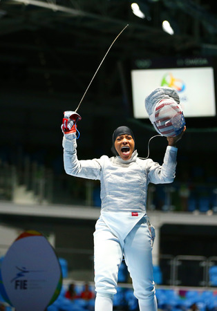 olympic ring: RIO DE JANEIRO, BRAZIL - AUGUST 8, 2016: Ibtihaj Muhammad of the United States competes in the Womens individual sabre of the Rio 2016 Olympic Games at the Carioca Arena 3 Editorial