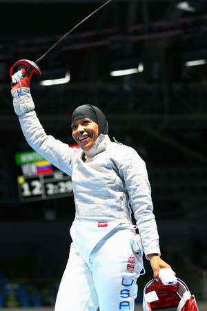 olympic symbol: RIO DE JANEIRO, BRAZIL - AUGUST 8, 2016: Ibtihaj Muhammad of the United States competes in the Womens individual sabre of the Rio 2016 Olympic Games at the Carioca Arena 3 Editorial
