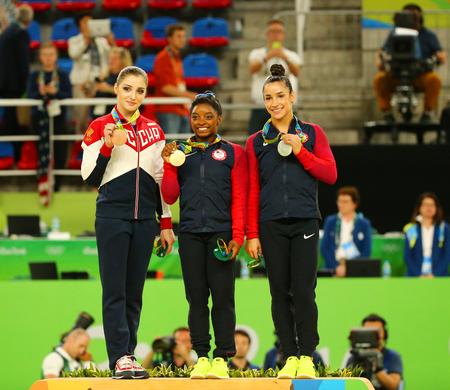 simone: RIO DE JANEIRO, BRAZIL - AUGUST 11, 2016:Womens all-around gymnastics winners at Rio 2016 Olympic Games Aliya Mustafina of Russia (L), Simone Biles of USA and Aly Raisman of USA during medal ceremony Editorial