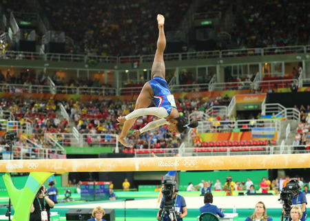olympic ring: RIO DE JANEIRO, BRAZIL AUGUST 8, 2016: Olympic champion Simone Biles of United States competing on the balance beam at womens all-around gymnastics at Rio 2016 Olympic Games Editorial